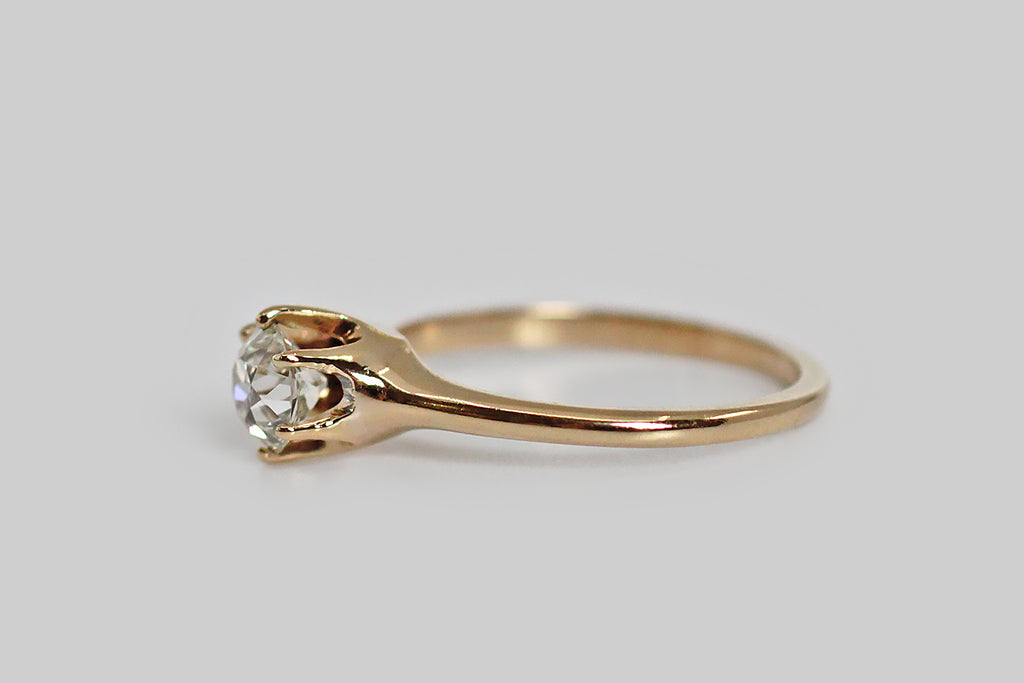 A classic, Edwardian-era engagement ring, modeled in warm 14k yellow gold, and set with a fiery, .75 carat, old European cut diamond. This sleek, six-prong setting holds its diamond very slightly aloft, making this engagement ring lower profile than similar period settings. The half round shank tapers subtly from the shoulder. This OEC diamond is full of fire, and has a nice high color. Clean, elegant, timeless style.