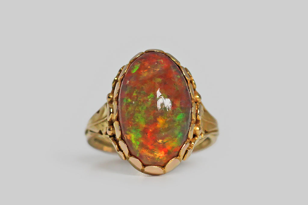 Arts & Crafts Era Opal Ring with Oak Leaf Trinity Shoulders in 18k Gold