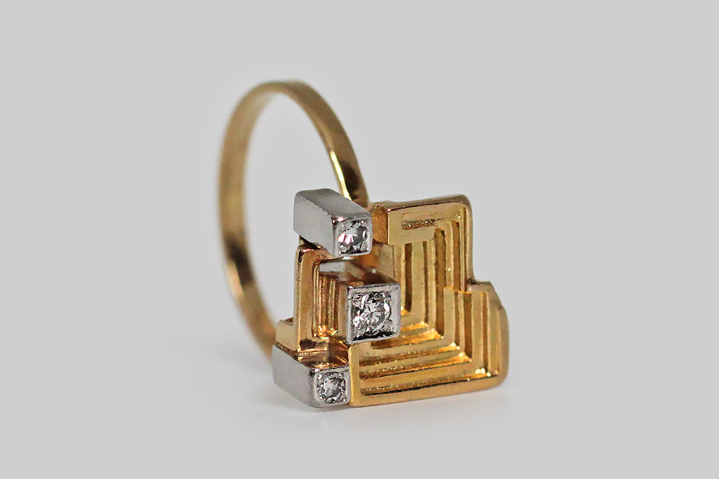A striking Mid-20th-century, Modernist ring, modeled in 18k gold, by the well-loved Finnish designer Bjorn Weckstrom, for Lapponia. Weckstrom's jewelry is both earthy and intellectual— this design is called Sun Temple. The ring's sculptural head closely resembles the chemical element bismuth, which occurs in these amazing stair-step forms; it also calls to mind the ruins of the grand Mayan temples that give the design its name.
