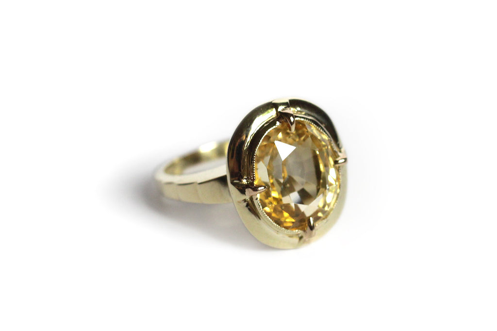 Nine Carat Yellow Sapphire Ring with Stepped Shoulders