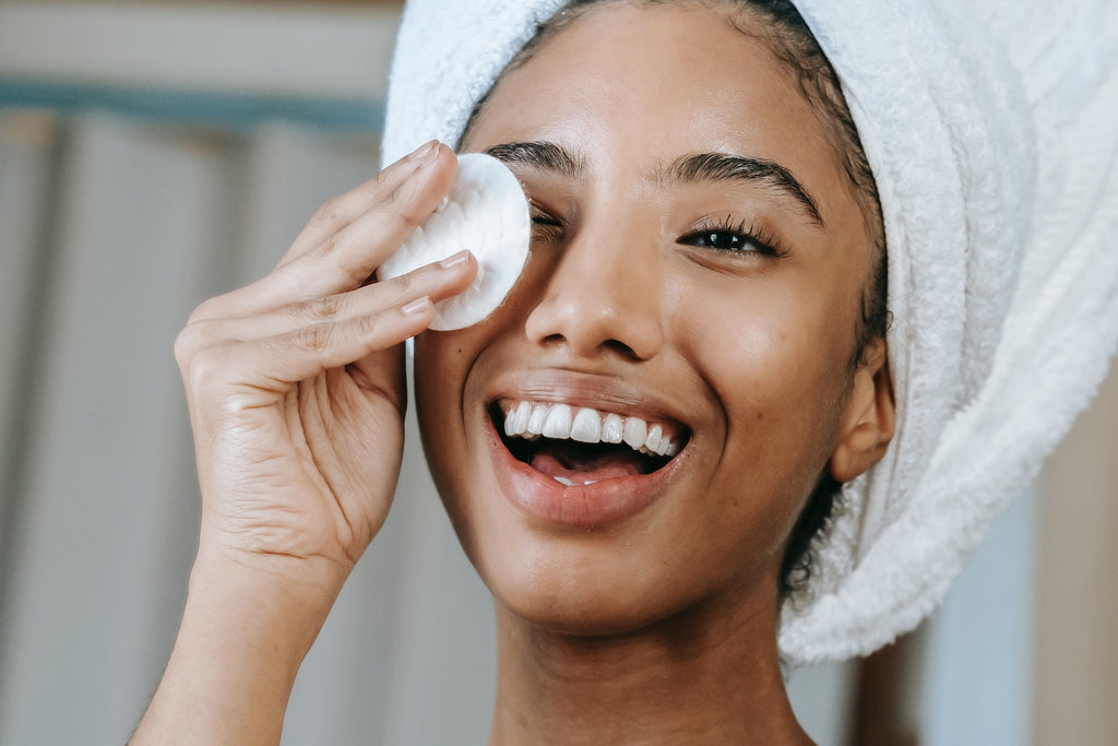 woman using skincare routine for acne