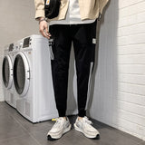 2020 New Hot Jogger Sports Trousers Men Hip Hop Streetwear Pocket Cargo Pants Fashion Reflective Beam Foot Men Pants