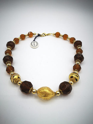 Necklace with Murano beads. Gold on Amber glass.