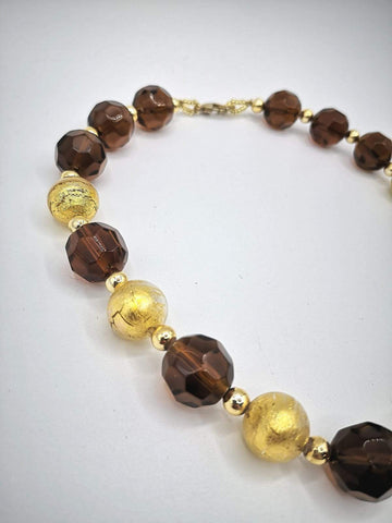 Necklace with Murano beads. Gold on bronze colored glass.
