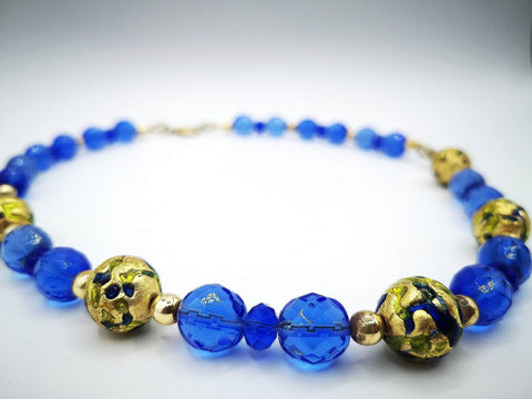 Necklace with Murano beads. Gold on blue glass.