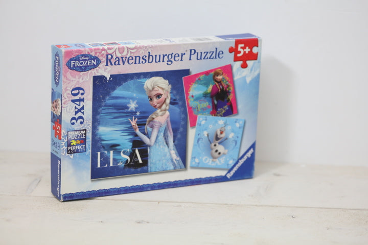 Tweedehands puzzel ravensburger frozen elsa