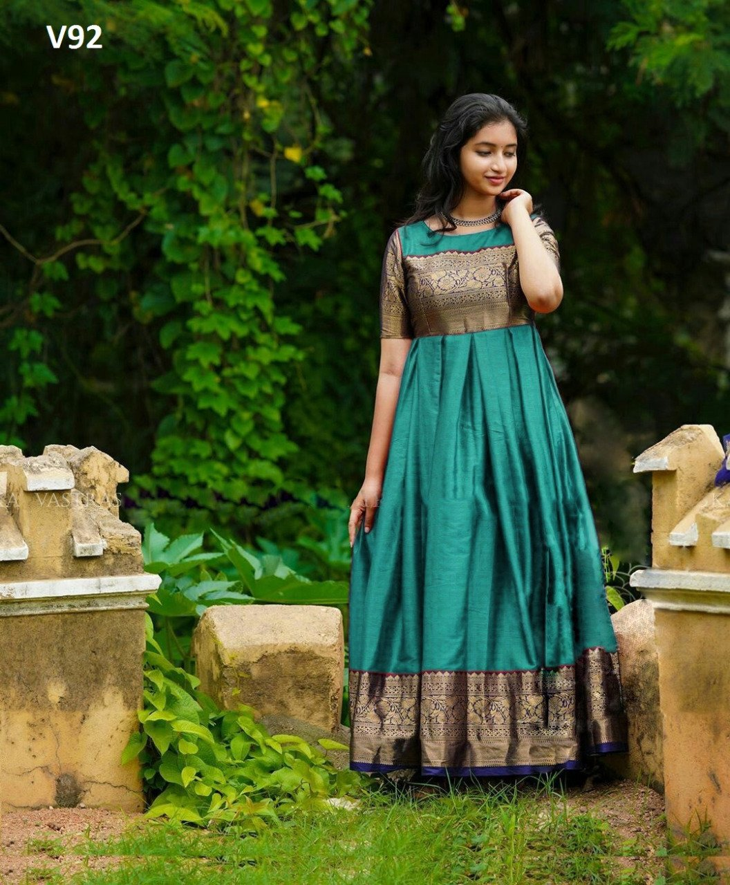 INTRICATE GREEN COLORED PARTYWEAR WOVEN SOFT SILK JACQUARD GOWN