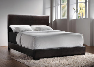Open image in slideshow, Conner Collection - Dark Brown - Conner Eastern King Upholstered Panel Bed Dark Brown