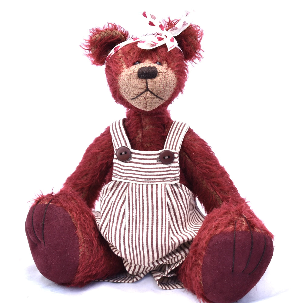 Maroon teddy bear sitting
