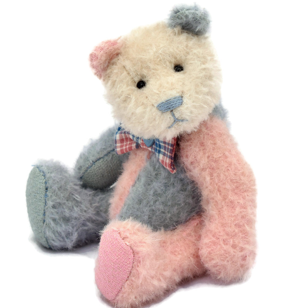 Blue and pink panda teddy bear sitting