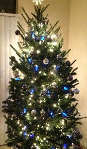 christmas trees decorated with blue color led mini lights and silver ornaments are elegant and classy combine your blue led lights with red and white led - Christmas Tree With White Lights And Red Decorations