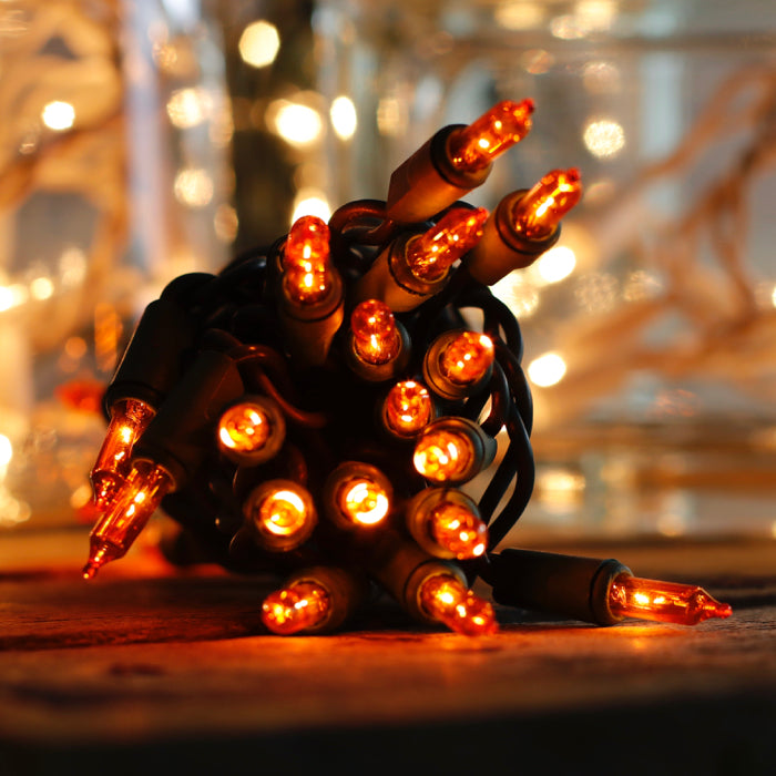 35 orange mini lights green wire stackable plug