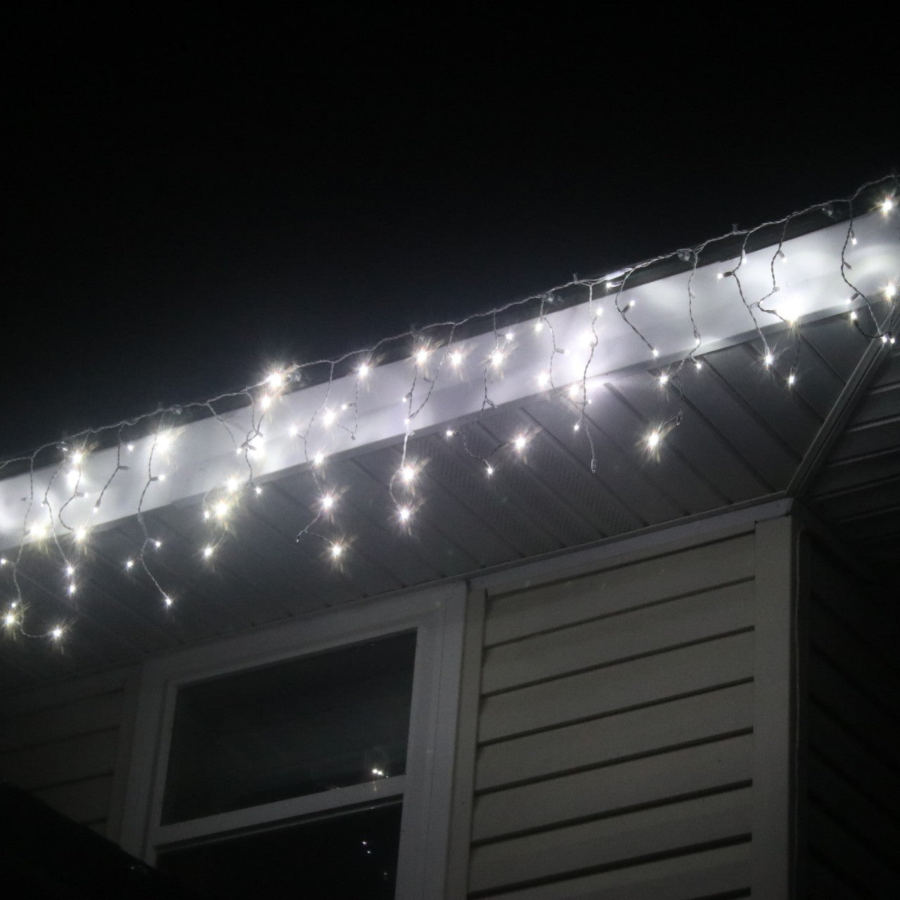LED Icicle Twinkle Lights - Pure White on Green Wire