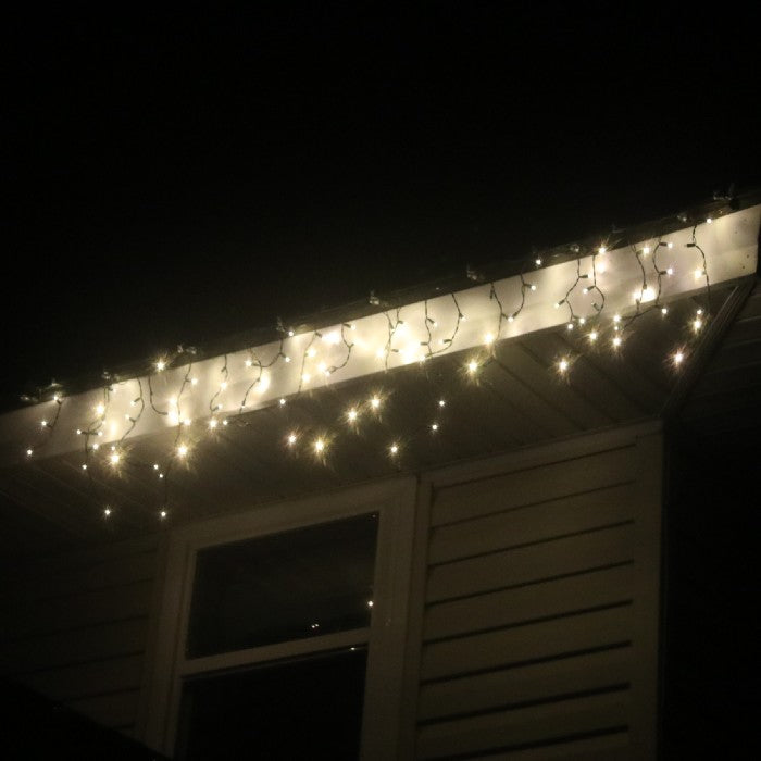 LED Icicle Twinkle Lights - Warm White on White Wire