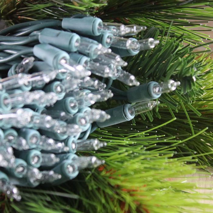 White Christmas lights on green wire - 100 bulbs 4 inches apart