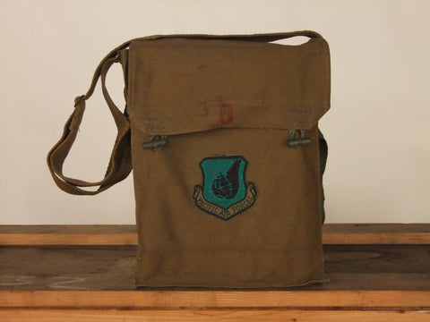 Khaki army surplus  bag with emblem.