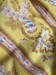 Antique printed French cotton textile in bblue white and pink on a yellow ground | Pavilion Parade