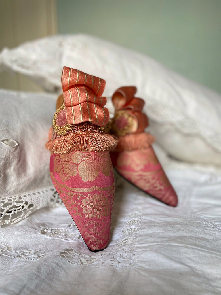 Pavilion Parade handmade shoes created from antique textiles,  available from Joanne Fleming Design. Antique kimono silk and 19th century passementerie create bohemian flat shoes in shades of pink and gold.