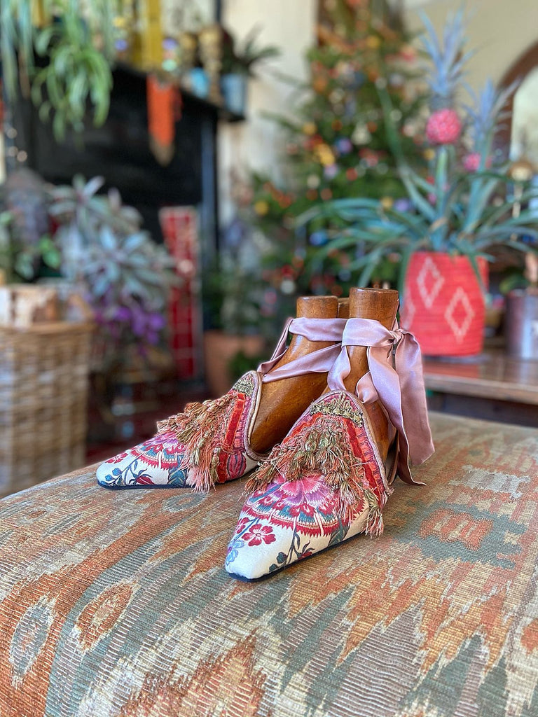 Pavilion Parade handmade shoes created from antique textiles, from available Joanne Fleming Design. 18th century Florentine silk tassels and block printed Indienne cotton create bohemian flat shoes in shades of coral, cream and gold.