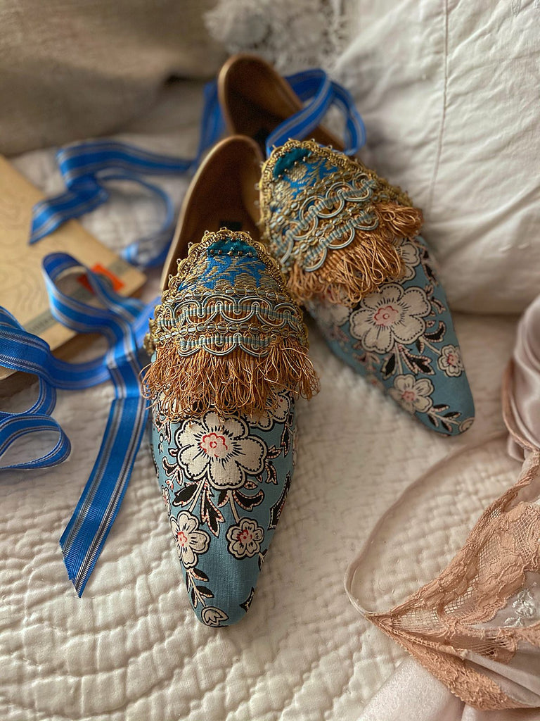 Flat shoes created from antique French Indienne printed cotton, embellished with antique silk passementerie fringe - tones of blue and gold - Pavilion Parade Signature Collection from Joanne Fleming Design