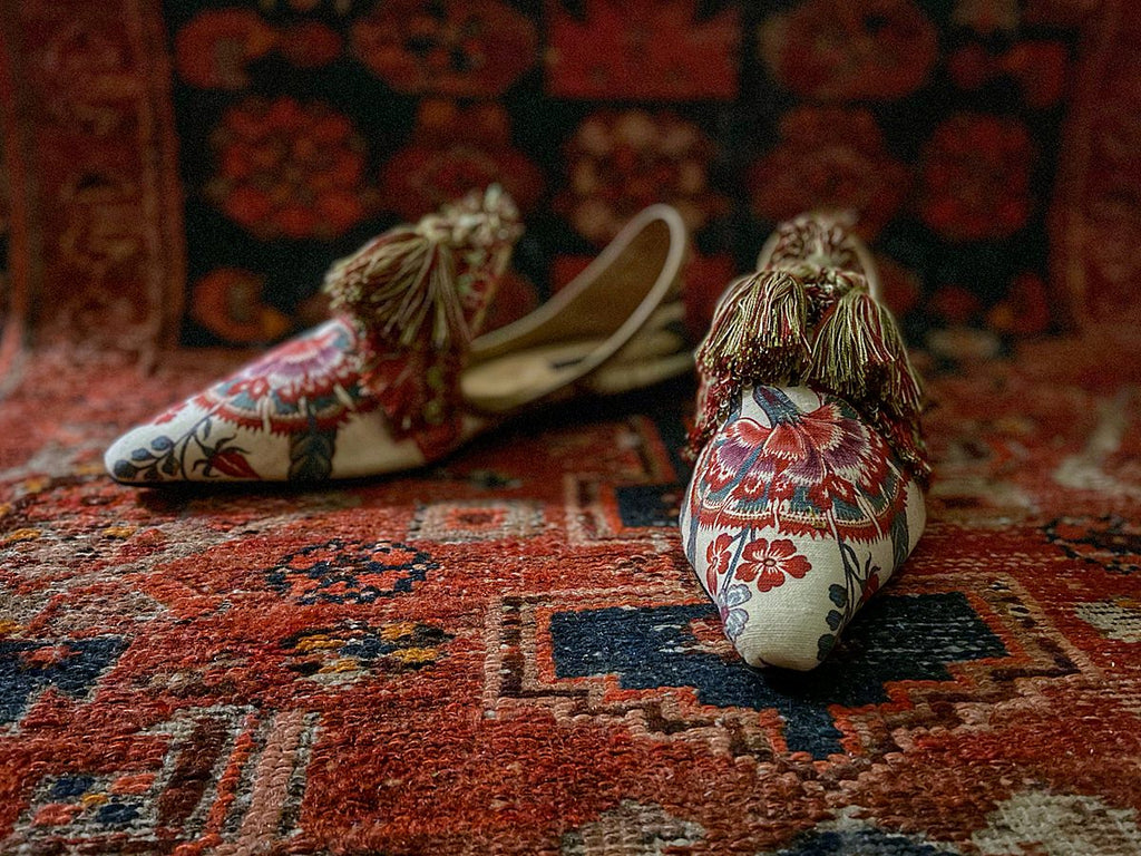 Tasseled bohemian flat shoes in antique textiles with silk ankle ties - muted tones of cream red and olive green - Pavilion Parade from Joanne Fleming Design