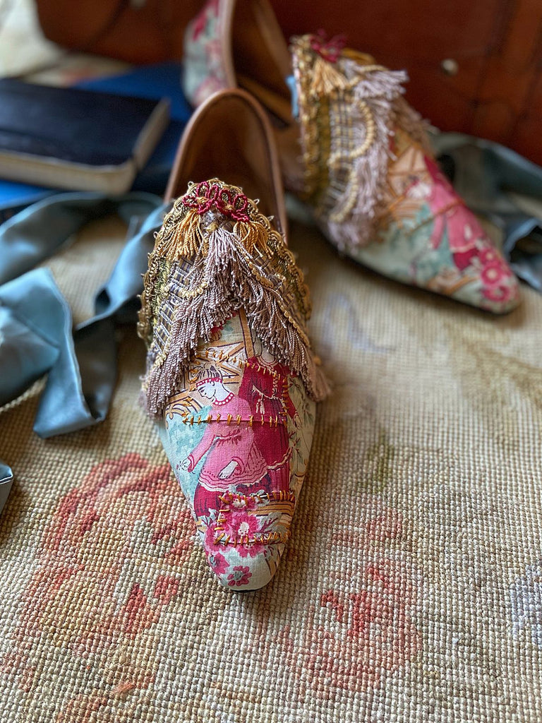 Flat shoes created from antique French Chinoiserie printed cotton, embellished with antique silk passementerie fringe - tones of blue and pink and gold