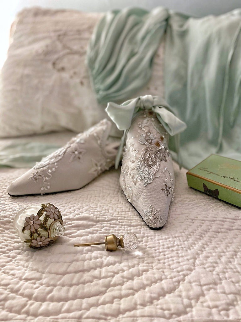 Enchanted Forest limited edition couture bridal shoes from the Pavilion Parade Recherché Collection by Joanne Fleming Design | silver grey silk satin with green ankle ties and beaded embellishment