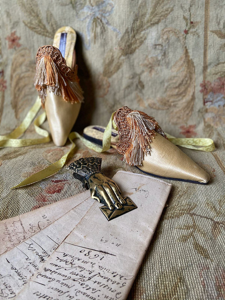 Pavilion Parade handmade bohemian shoes created from antique textiles, from Joanne Fleming Design. 19th century Florentine silk fringe and straw silk satin create bohemian flat shoes in shades of pale gold and apricot