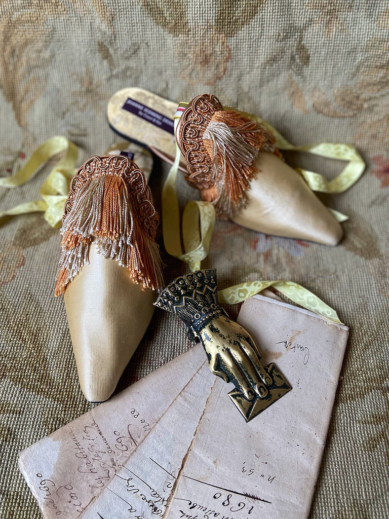 Pavilion Parade handmade bohemian shoes created from antique textiles, from Joanne Fleming Design. 19th century Florentine silk fringe and straw silk satin create bohemian flat shoes in shades of gold and apricot