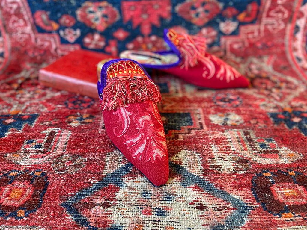 Pavilion Parade handmade bohemian shoes created from antique textiles, from Joanne Fleming Design. 19th century Florentine silk fringe and block printed French cotton create bohemian flat shoes in shades of red and purple