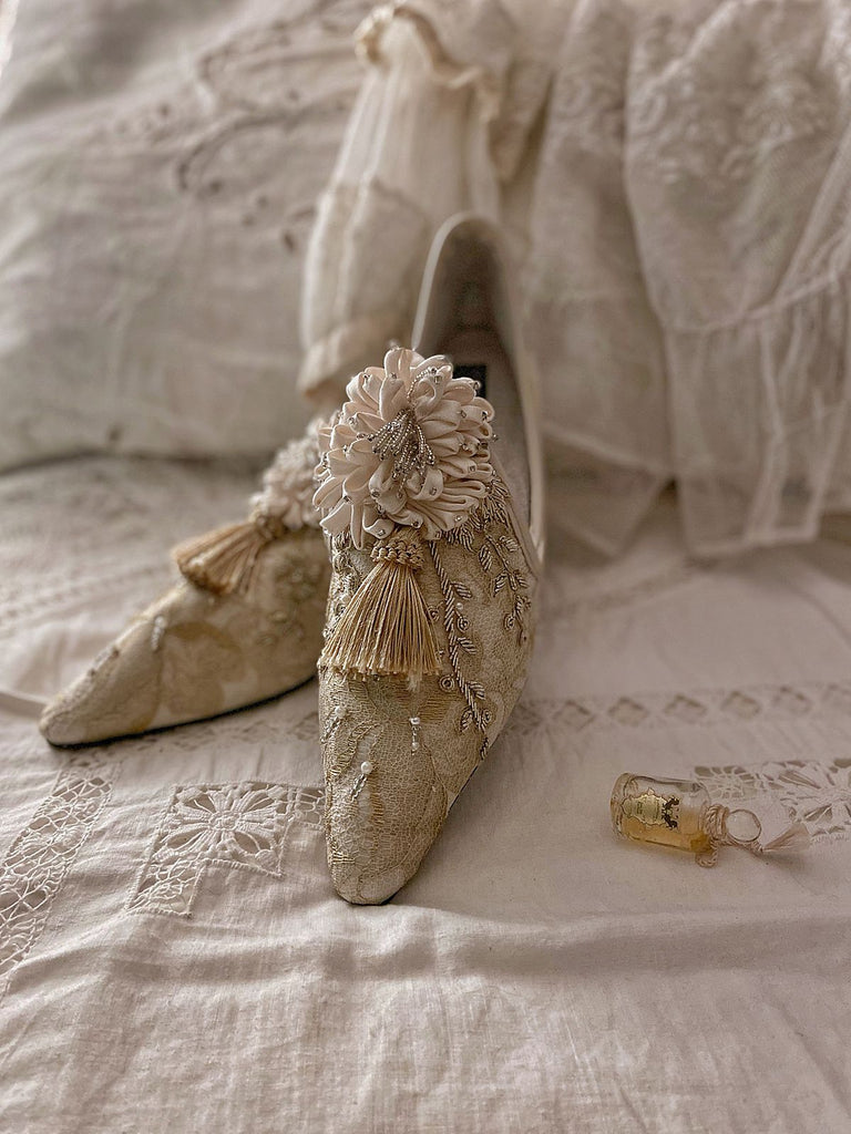 Gold French lace and silk Valmont bridal shoes with silk rosette | The Recherché Collection from Joanne Fleming Design