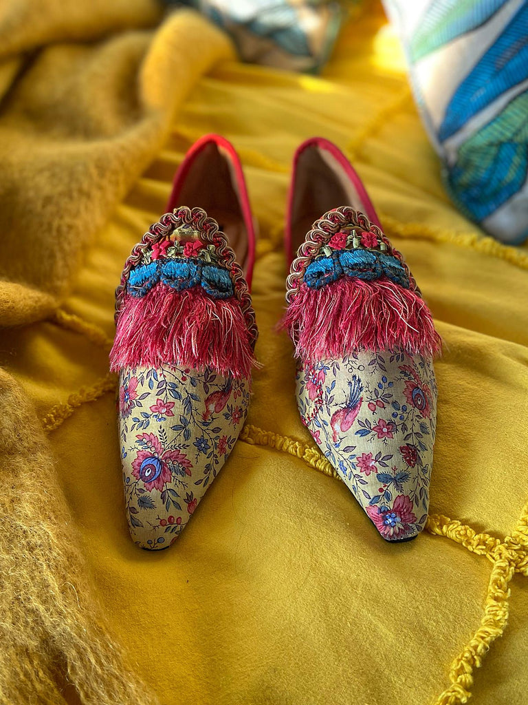 Xanadu yellow and floral shoes with fringed embellishment, created from antique textiles, from the Sigtnature Collection of bohemian footwear by Pavilion Parade at Joanne Fleming Design