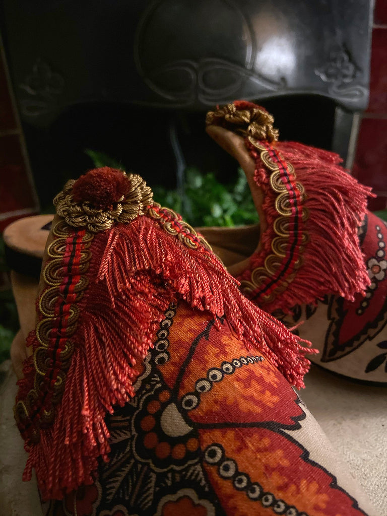 Sienna antique French toile bohemian shoes with silk fringe and tassels in shades of burnt orange and red, by Pavilion Parade from Joanne Fleming Design