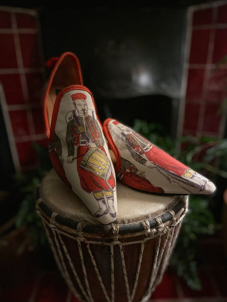 Bohemian shoes created from antique French printed cotton, embellished with antique silk tassels- tones of turkey red, black and yellow - Pavilion Parade Signature Collection from Joanne Fleming Design