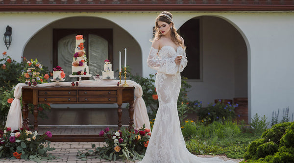 Bride and sweet table at outdoor Spanish inspired wedding