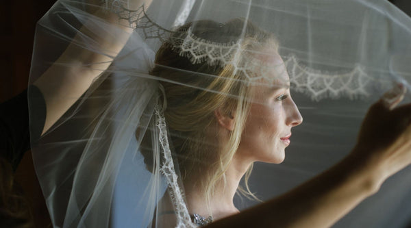 bride putting on a veil