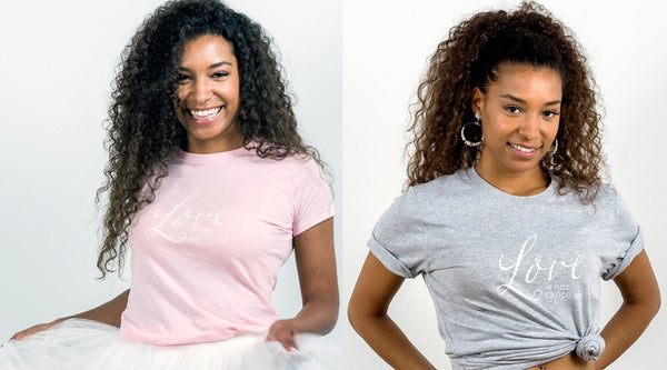 happy girls with curls wearing t-shirts