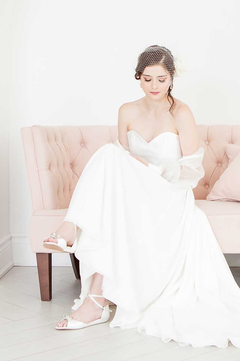 Angela Nuran Audrey flat wedding shoes on bride with birdcage veil