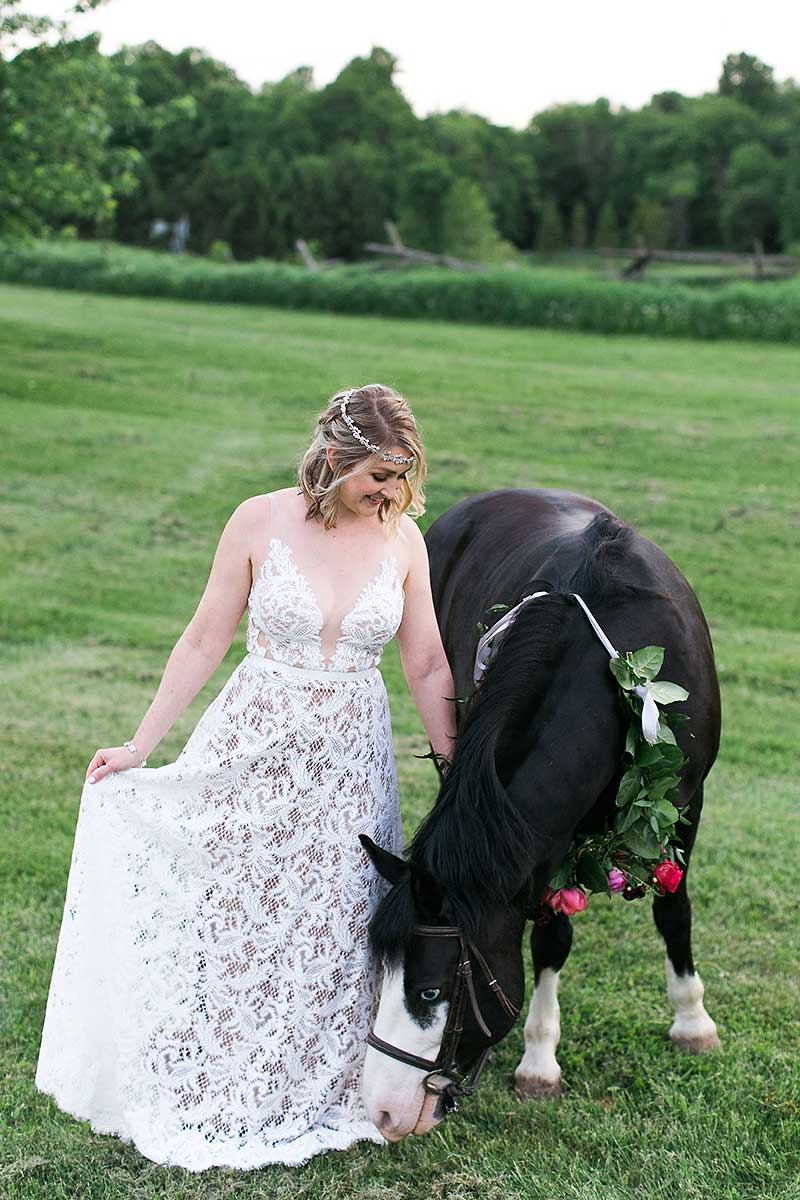 Bohemian free spirit smiling bride with a horse