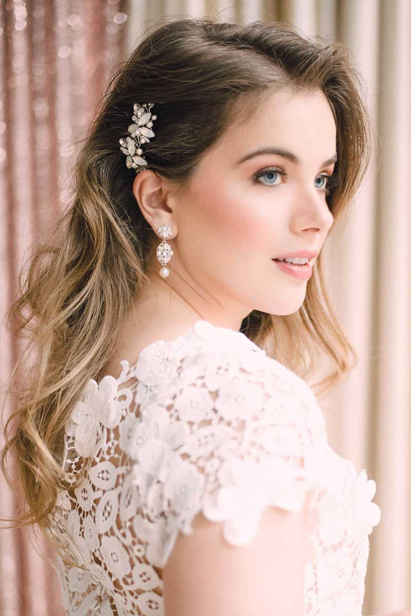 Profile view of bride with effortless waves hairstyle and small side combs hair accessories