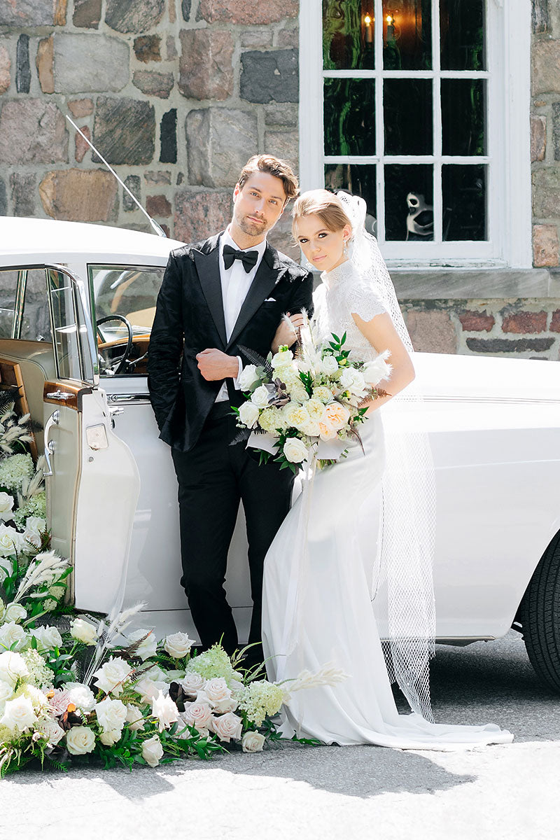 Groom in tux and Bride in French net headpiece