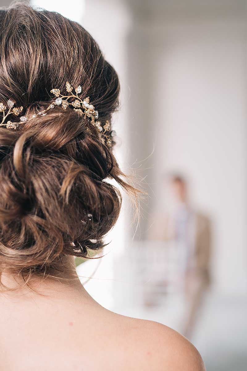 back view of messy bun hairstyle with Laura Jayne Wisteria hairvine