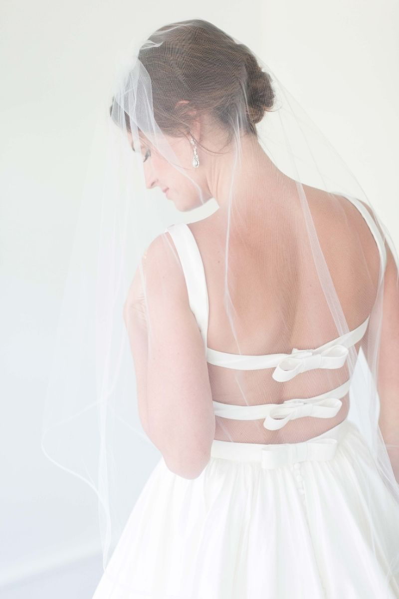 smiling bride standing in a backless dress
