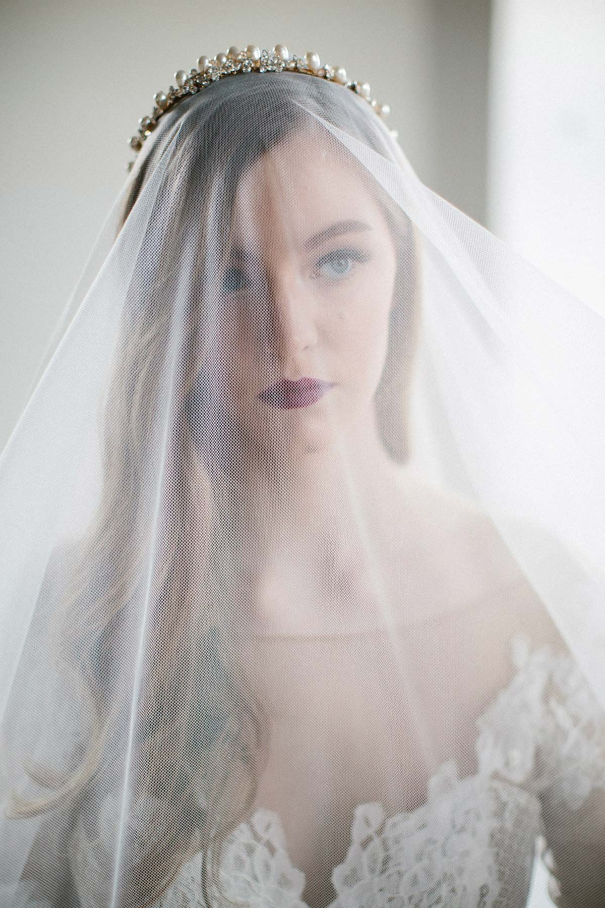 bride wearing a headpiece and a veil