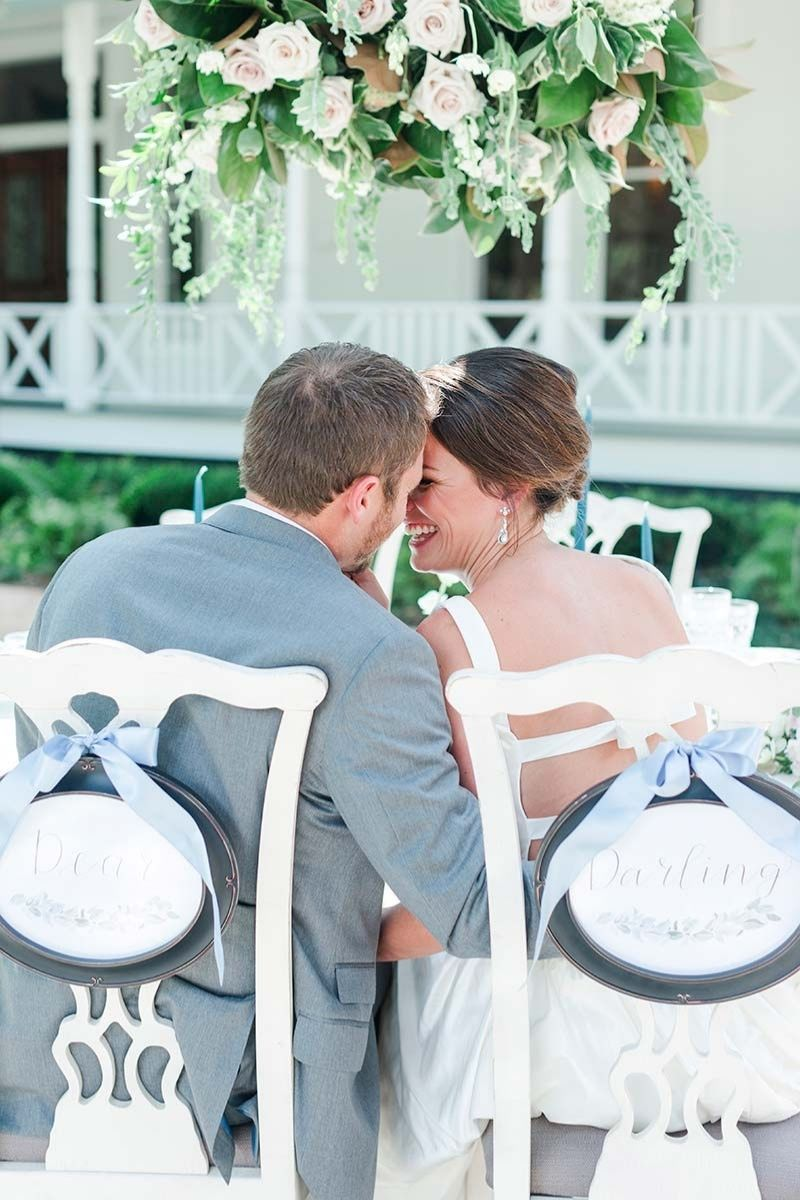 couple sitting at the wedding table
