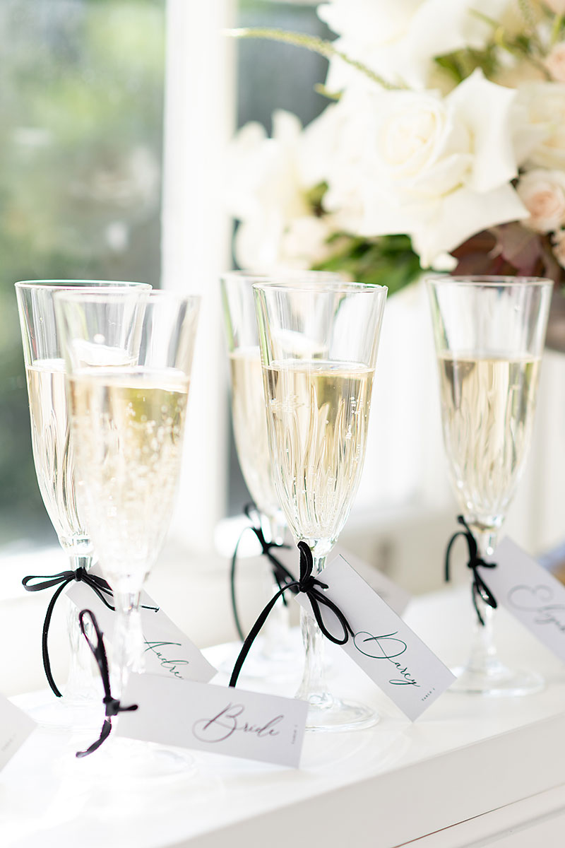 Champagne flutes with black ribbon and b&w stationery