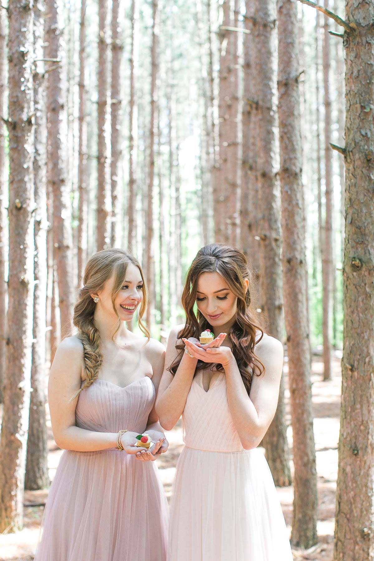 two brides maids smiling in the woods