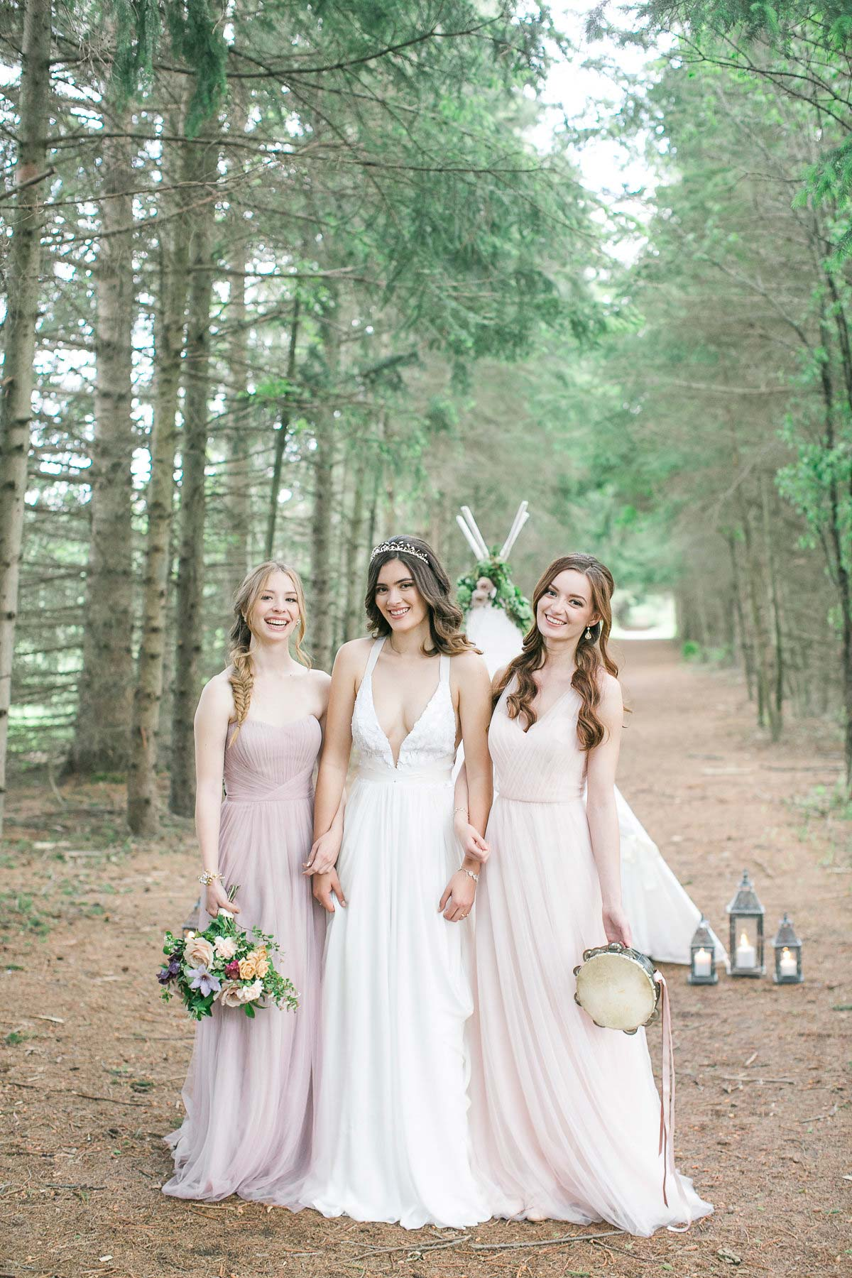 three happy bridesmaids walking in the woods