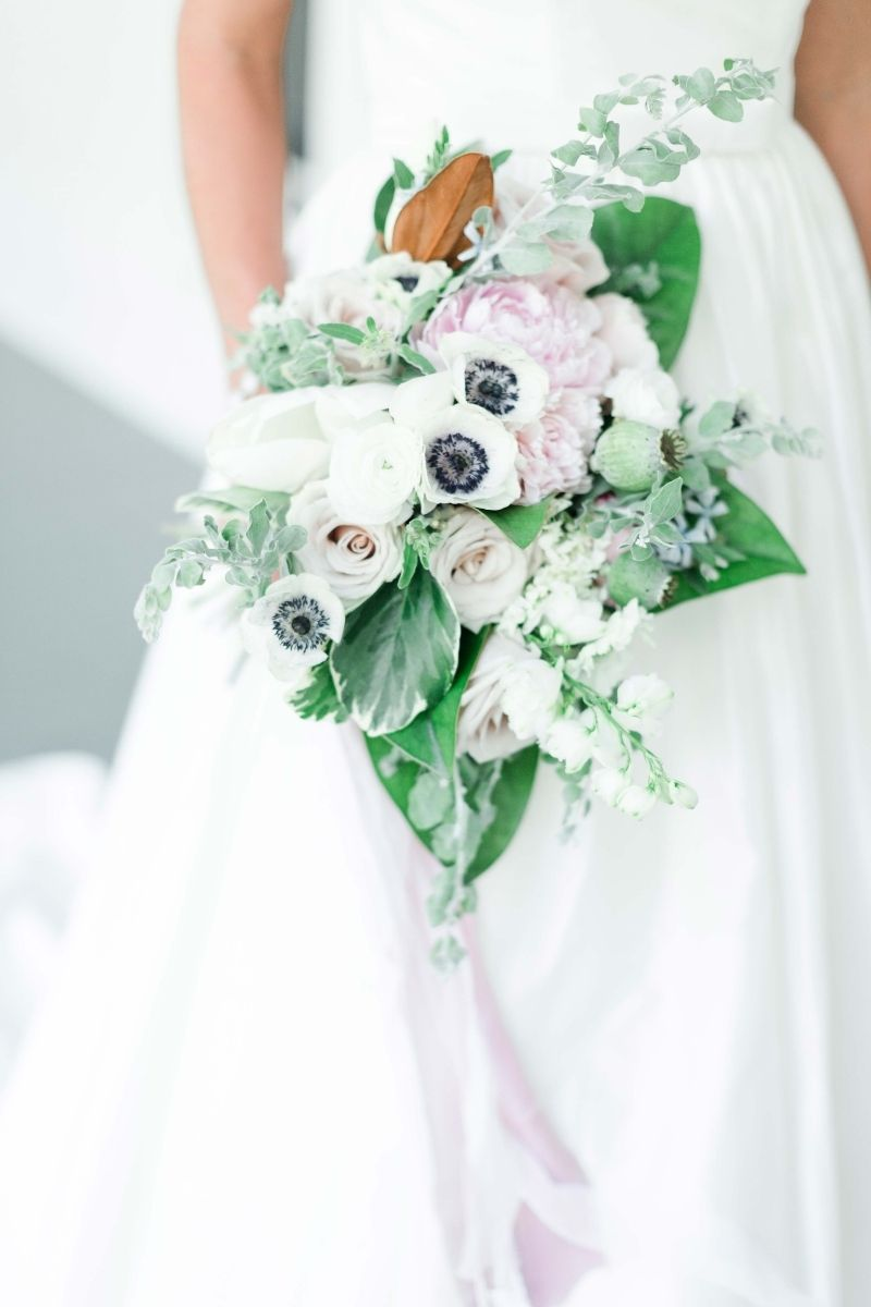 half of the wedding dress and a lower bouquet
