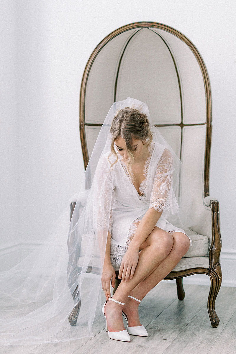 bride in veil and shoes getting ready